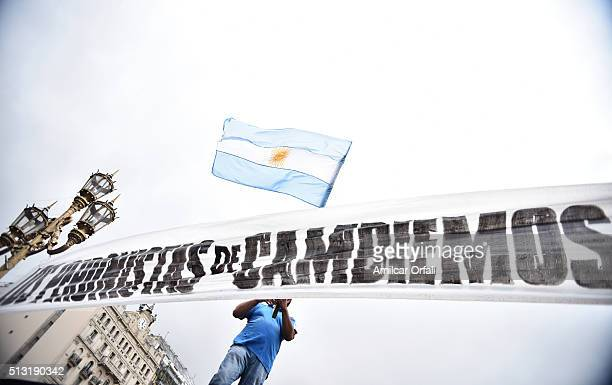 A man waves a flag of Argentina after the inauguration of the 134th Period of Congress Ordinary Sessions on March 01 2016 in Buenos Aires Argentina