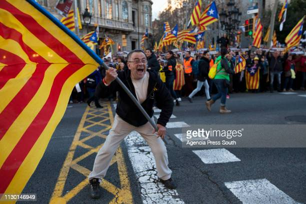 A man waves a flag with the colors of Catalonia during a protest against the Proindependence leaders trial on February 16 2019 in Barcelona Spain The...