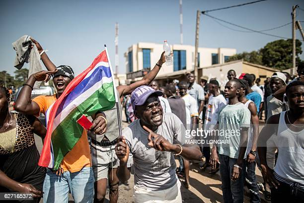 A man waves a Gambian flag as he celebrates the victory of Gambia's opposition candidate Adama Barrow during the Presidential Elections on December 2...