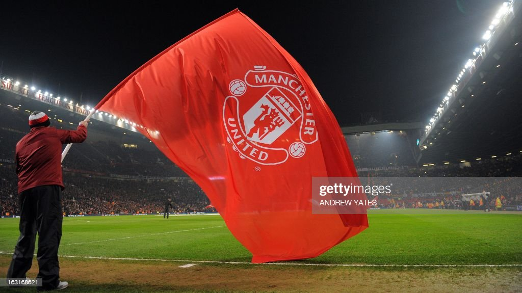 A man waves a manchester united flag before the uefa champions a man waves a manchester united flag before the uefa champions league round of 16 second voltagebd Image collections