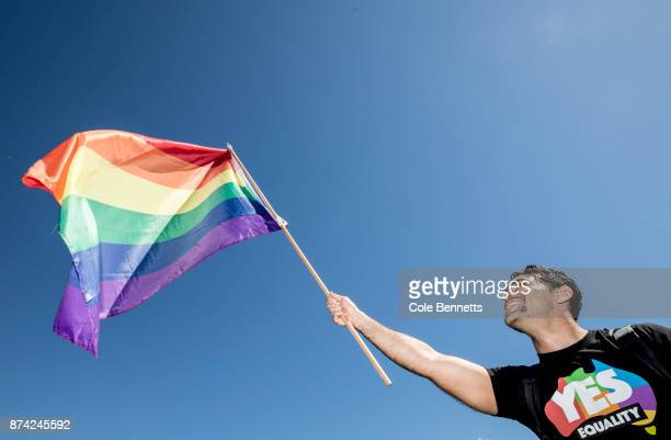 A man waves a rainbow flag on November 15 2017 in Sydney Australia Australians were asked to vote in the Australian Marriage Law Postal Survey...