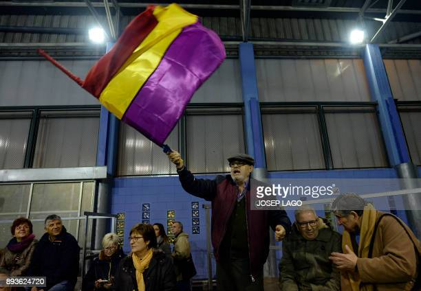 A man waves a Republican flag during a campaign meeting of 'Catalunya en comu podem' electoral coalition for the upcoming Catalan regional election...