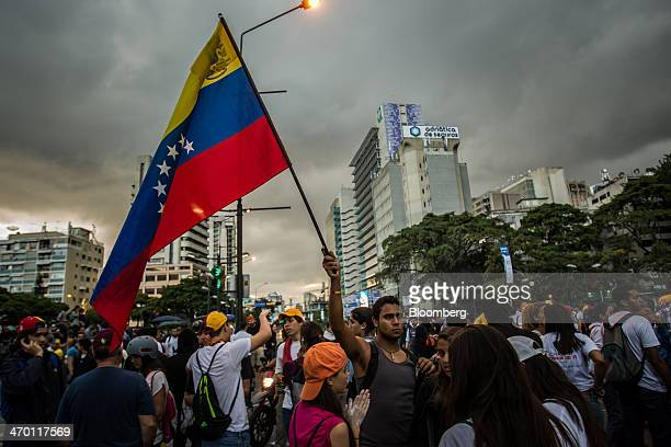 A man waves a Venezuelan flag during a demonstration by a group made up of mostly students in Caracas Venezuela on Monday Feb 17 2014 Venezuela's...