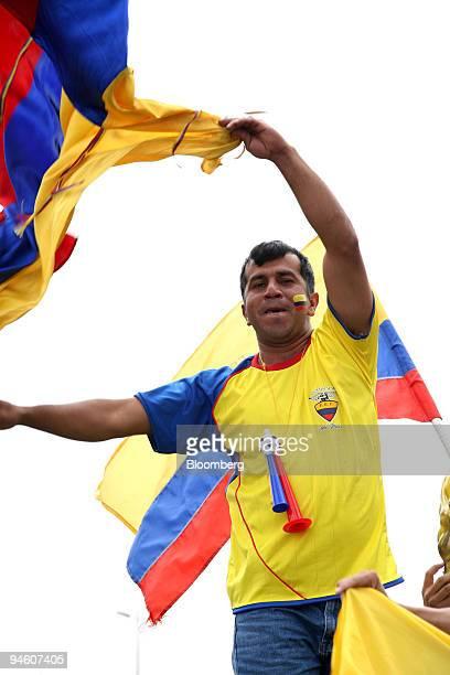 A man waves an Ecuadorian flag in Quito Ecuador Thursday June 15 2006 World Cup host Germany Ecuador and England became the first teams to reach the...
