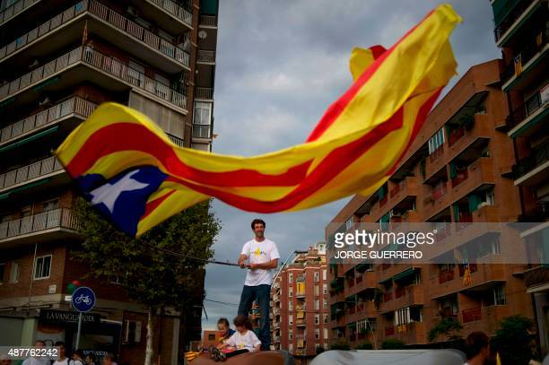 A man waves an 'Estelada' during celebrations of Catalonia's National Day which recalls the final defeat of local troops by Spanish king Philip V's...