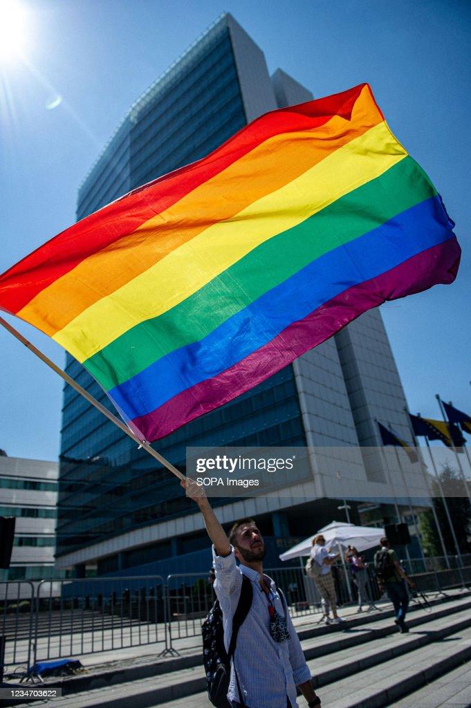 A man waves an LGBT flag in front of the Bosnian parliament... : News Photo