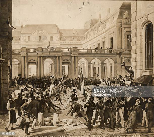 A man waves the republican tricolor as the Duc d' Orleans makes his way on horseback through the barricades to the Hotel de Ville in Paris during the...