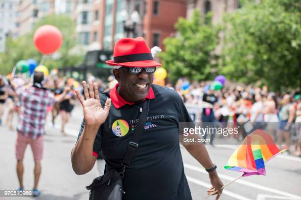 A man waves to a crowd on Boylston St during the 2018 Boston Pride Parade on June 9 2018 in Boston Massachusetts