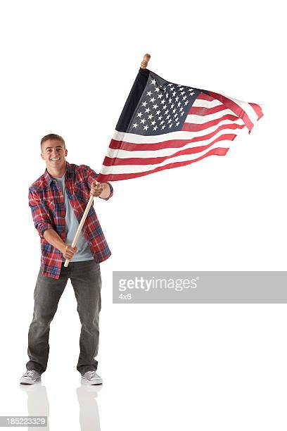 man waving an american flag - flag stock pictures, royalty-free photos & images