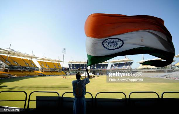 A man waving an Indian flag during a training session at the MA Chidambaram Stadium in Chepauk Chennai on 19h March 2011