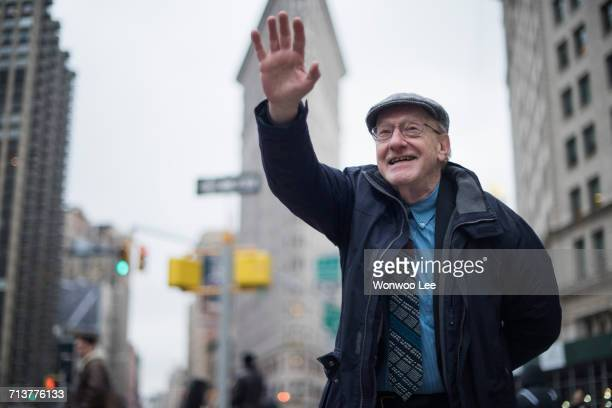 Man waving and smiling, Manhattan, New York, USA