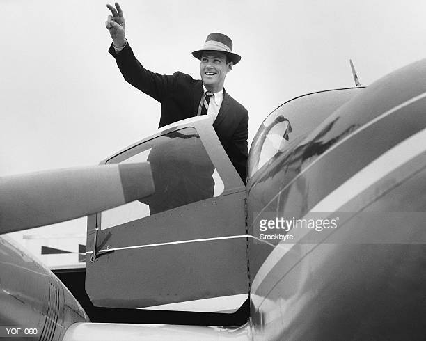 man waving, getting in plane - waving gesture stock photos and pictures