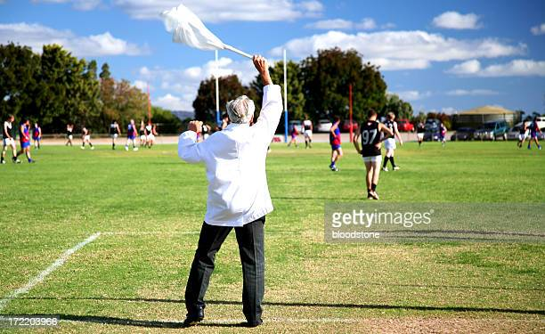 man waving racket during a game - afl stock pictures, royalty-free photos & images