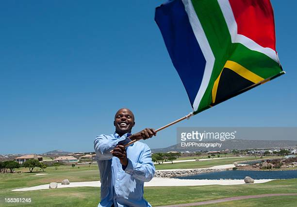 man waving south african flag - south african flag stock photos and pictures