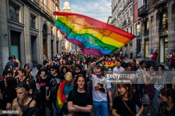 A man waving the rainbow flag during a demonstration for the International Day against Homophobia Transphobia and Biphobia