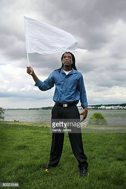 man (30) waving the white flag