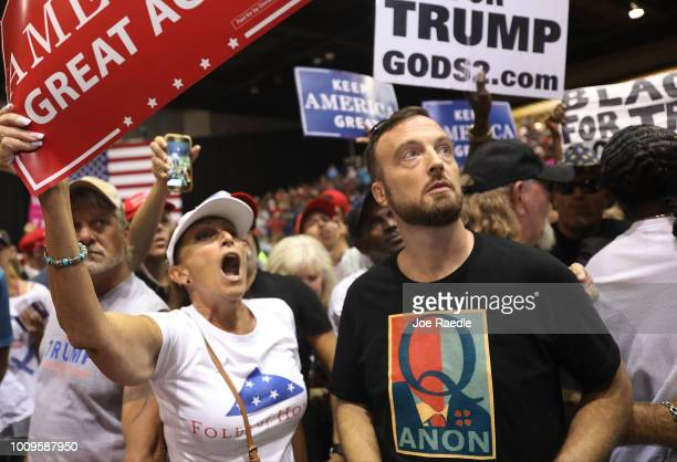 A man wear a shirt with the words Q Anon as he attends a rally for President Donald Trump at the Make America Great Again Rally being held in the...