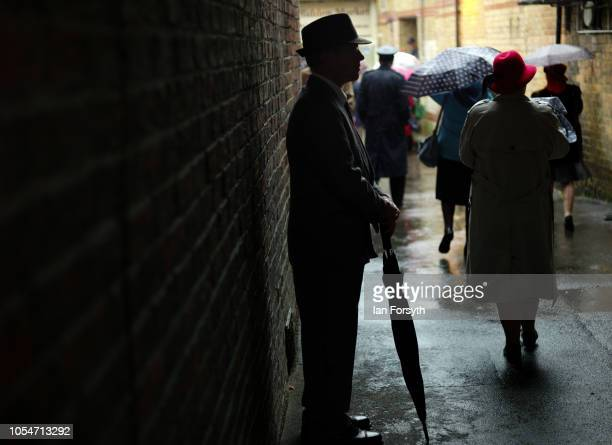 A man wearing 1940's period clothing shelters from heavy rain during the North Yorkshire Moors Railway 1940's Wartime Weekend event on October 14...
