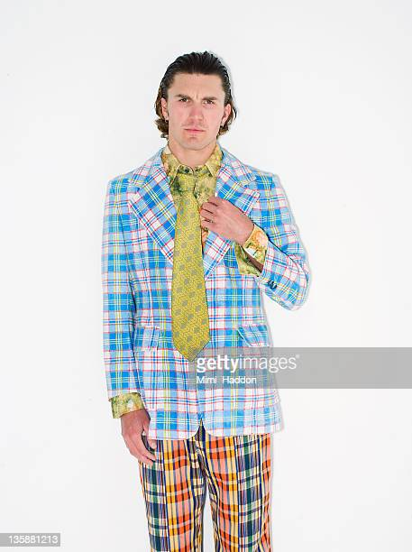 man wearing 1980s plaid jacket and pants - fashion oddities stock pictures, royalty-free photos & images
