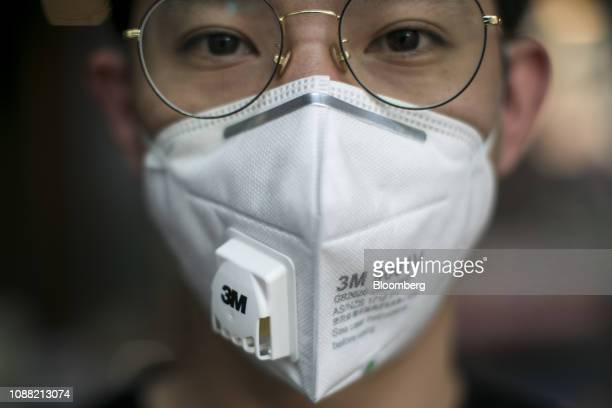 A man wearing a 3M Co mask poses for a photograph in Bangkok Thailand on Friday Jan 25 2019 Outpatient visits at Ladprao General Hospital Pcl...