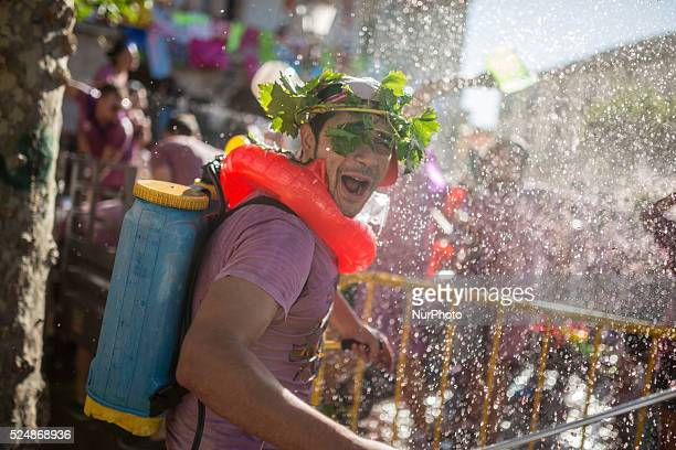 A man wearing a backmounted spraying device enjoy the Batalla del Vino in Toro on August 24 2015 Toro a small village of Spain known for having Toro...
