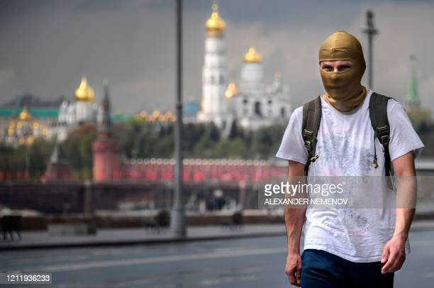 Man wearing a balaclava walks in downtown Moscow on May 6 amid the spread of the new coronavirus COVID-19.