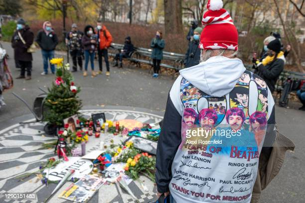 "Man wearing a Beatles jacket stands at the ""Imagine"" memorial on the 40th anniversary of John Lennon's death at Strawberry Fields, Central Park on..."
