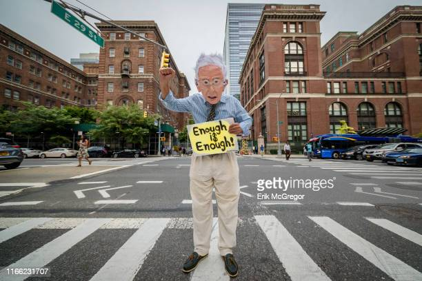 Man wearing a Bernie Sanders mask joined advocates with T1Internationals New York, New Jersey, and Connecticut Chapters at a vigil on September 5,...
