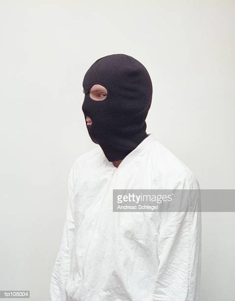 man wearing a black mask - balaclava stock pictures, royalty-free photos & images