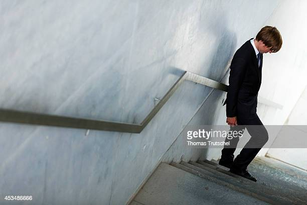 Man wearing a business suit stands at the bottom of a staircase on August 07 2014 in Berlin Germany