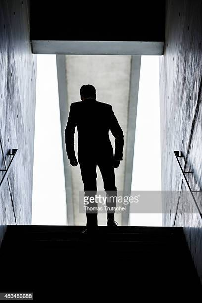 A man wearing a business suit walks down the stairs on August 07 2014 in Berlin Germany
