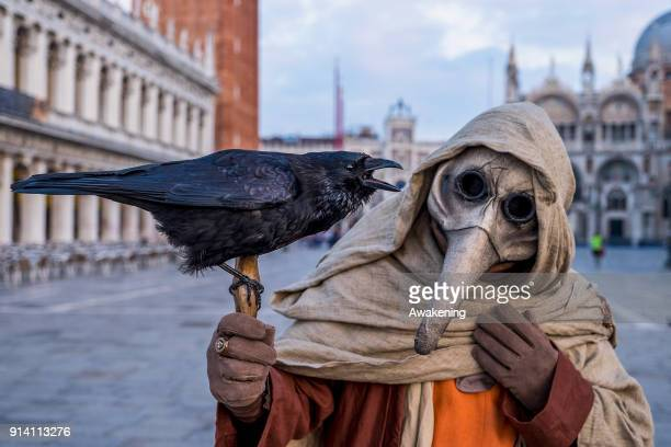 A man wearing a carnival costume attends the Flight of Angel in Saint Mark's Square on February 4 2018 in Venice Italy The theme for the 2018 edition...