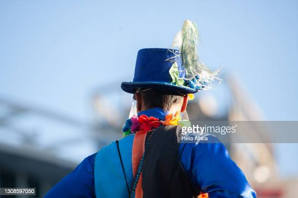 a man wearing a colorful costume & top hat. - offbeat stock pictures, royalty-free photos & images