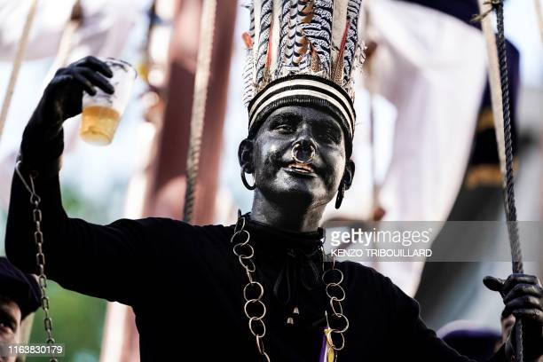 "Man wearing a controversial makeup colouring blackface and called ""the savage"" gestures during a folk parade ""Ducasse"" of Ath in Ath, Belgium on..."