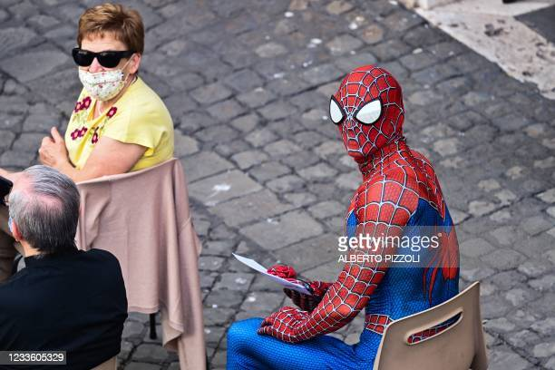 Man wearing a costume of the Spider-Man fantasy character waits for the Pope's arrival at San Damaso courtyard for the weekly general audience on...