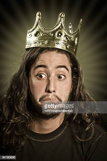 man wearing a crown and looking sad - crown stock pictures, royalty-free photos & images