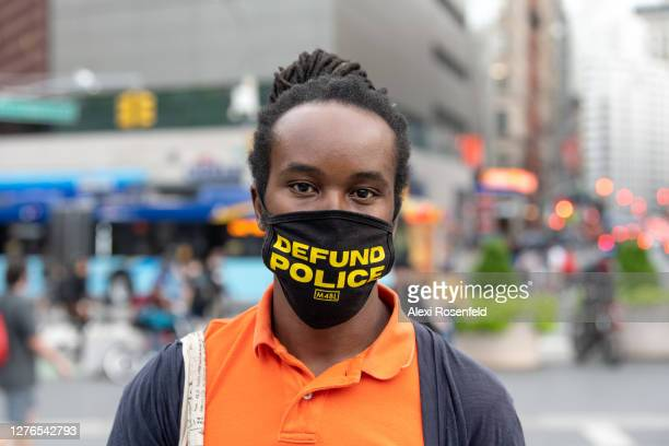 """Man wearing a """"defund police"""" mask poses in Union Square as the city continues Phase 4 of re-opening following restrictions imposed to slow the..."""
