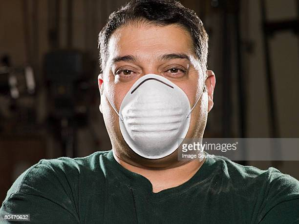 Man wearing a dust mask