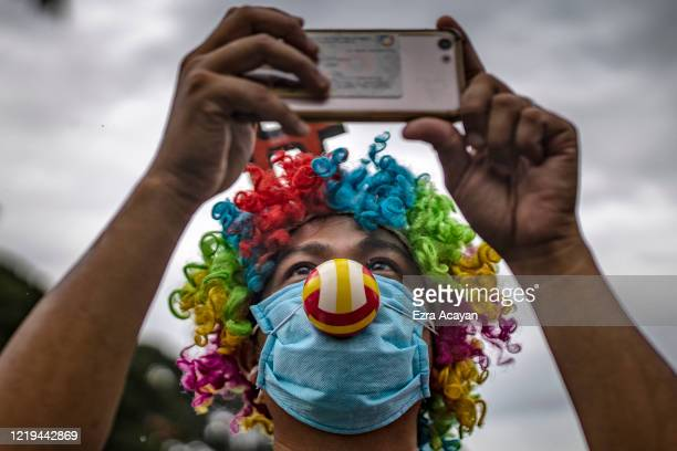 Man wearing a face mask and clown costume takes part in a protest against President Duterte's Anti-Terror bill on June 12, 2020 in Quezon city, Metro...
