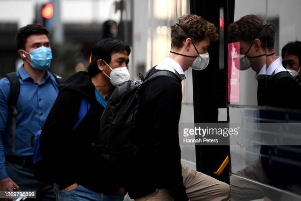 Man wearing a face mask boards a bus on August 31, 2020 in Auckland, New Zealand. Face coverings are now compulsory for all New Zealanders over the...