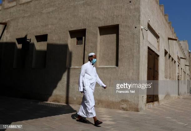 A man wearing a face mask is seen on March 26 2020 in Dubai United Arab Emirates The Coronavirus pandemic has spread to at least 182 countries...