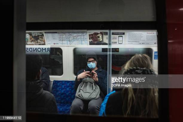 A man wearing a face mask seen in a tube The UK government has declared coronavirus a serious and imminent threat to public health as the total...