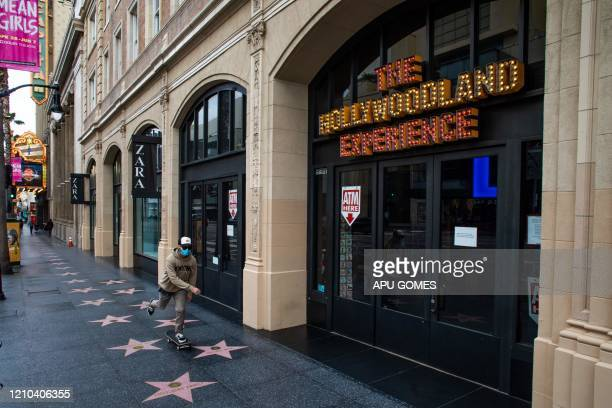 Man wearing a face mask skateboards down the Hollywood Walk of Fame in Hollywood on April 19 amid the novel coronavirus pandemic.