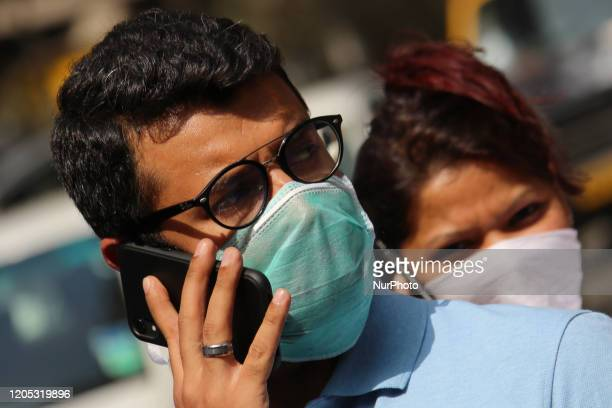 A man wearing a face mask talks on a mobile phone outside a hospital on March 05 2020 in Mumbai India An isolation ward has been set up at Kasturba...