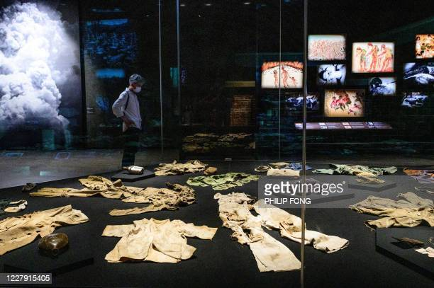 A man wearing a face mask visits Hiroshima Peace Memorial Museum in Hiroshima on August 5 2020 Japan on August 6 2020 will mark 75 years since the...