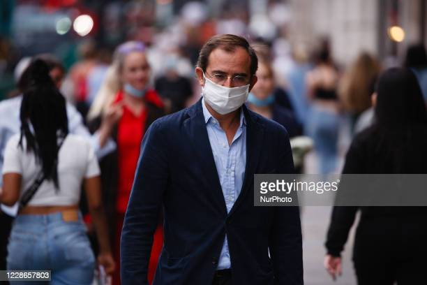 Man wearing a face mask walks along Regent Street in London, England, on September 22, 2020. British Prime Minister Boris Johnson this afternoon...