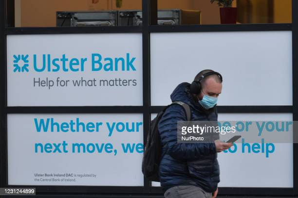 Man wearing a face mask walks by the Ulster Bank buildings on Georges Quay in Dublincity center during Level 5 COVID-19 lockdown. Tomorrow, Friday 19...