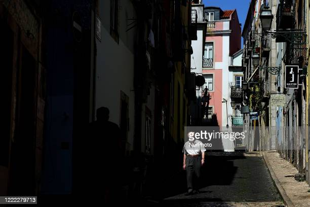 A man wearing a face mask walks in downtown Lisbon Portugal on June 23 during the COVID19 Coronavirus pandemic The Government applies today new...