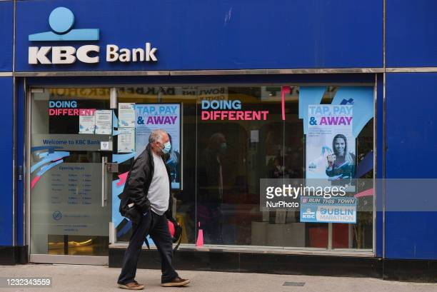 Man wearing a face mask walks past a KBC Bank branch in Dublin city centre. KBC Bank Ireland has announced today that it is in discussions about the...