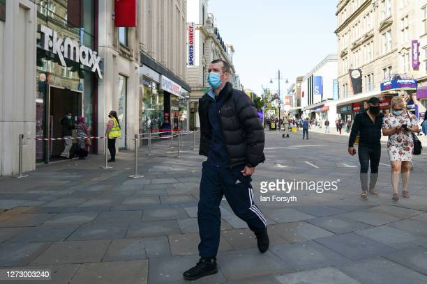 A man wearing a face mask walks through Newcastle city centre on September 17 2020 in Newcastle upon Tyne England Almost two million people in...